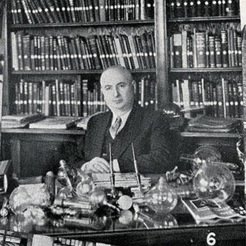 Charles (Károlyi) Eisler sitting at his desk