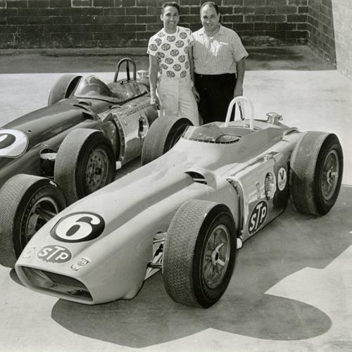 Andy Granatelli and his brother Vincent standing behind two race cars