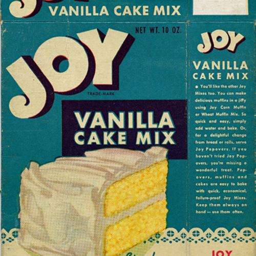 Detail of an illustrated cake mix box, with an aqua background and an drawing of a slice of yellow cake with white frosting.