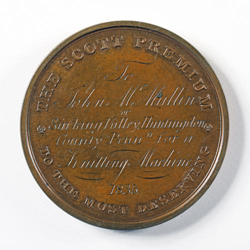 "The reverse side of the John Scott medal, inscribed, ""THE SCOTT PREMIUM TO THE MOST DESERVING To John McMullin [sic] of Sinking Valley, Huntingdon County Penna. for a Knitting Machine 1835."""