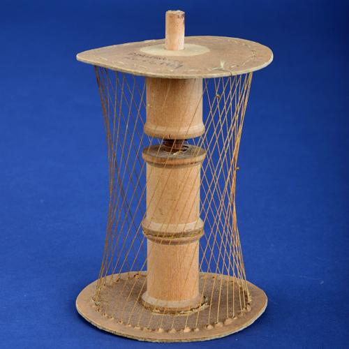 Hyperboloid model made of cardboard, wood, thread, wire, and thread spools