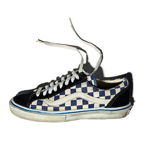 Vans blue and white checked skateboarding shoe with a dark blue suede toe and eyestay, white leather sidestripe, and the trademark deep tan, waffle pattern soles.