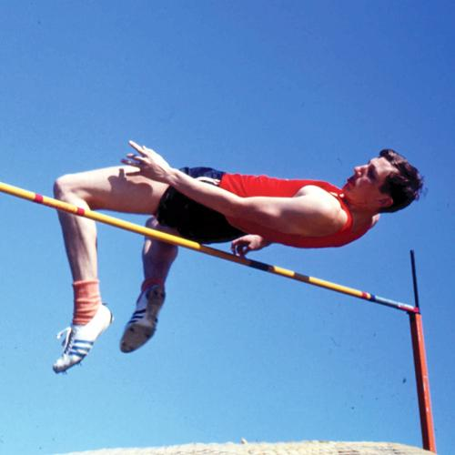 High jumper Dick Fosbury goes over the bar head first with his back to the bar.