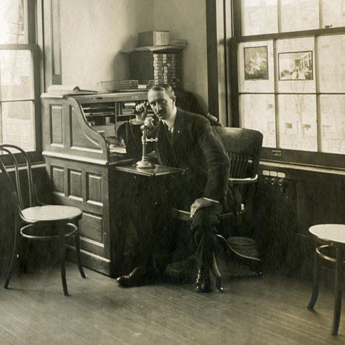 Photo of Charles Pratt in his office around 1900