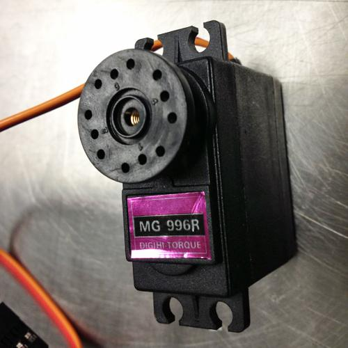 Close-up of a small servo motor labeled MG996R Digihi Torque