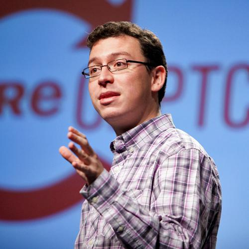 Luis von Ahn stands in front of a large red ReCAPTCHA logo while speaking at the 2009 Pop!Tech conference in Camden, Maine.