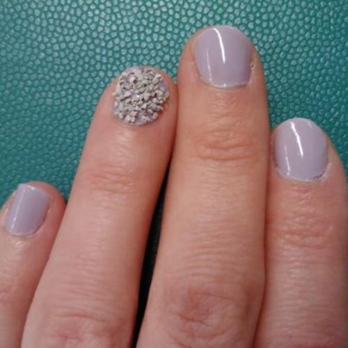 hand with textured manicure