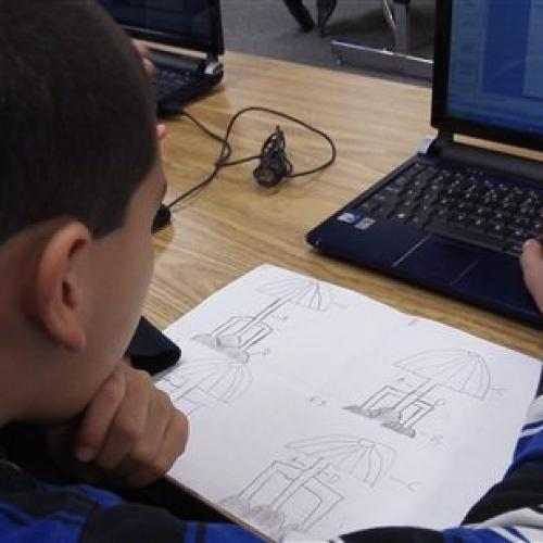 A student uses CAD software on a laptop