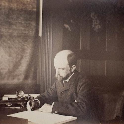 Henry Adams seated at his desk, 1883.