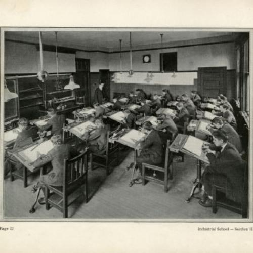 Archival photo of boys at their desks, 1911.