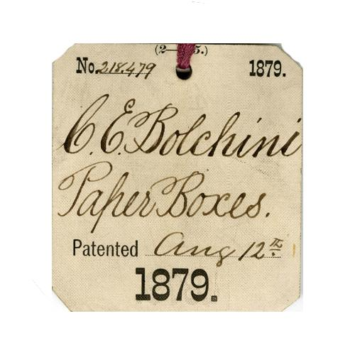 Patent tag for Paper box by Charles E. Bolchini, 1879.