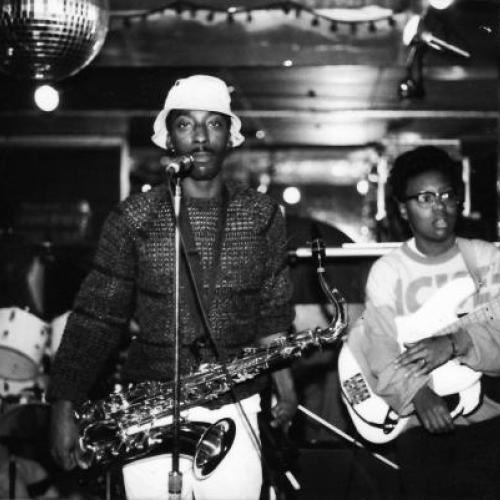 "Little Benny and the Masters (Rory ""DC"" Felton on saxophone and MeShell Ndegeocello on bass) at the Metro Club, 1986. Photograph by Thomas Sayers Ellis, used with permission."