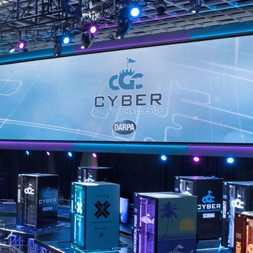 Competing systems on stage at the DARPA Cyber Grand Challenge, 2016