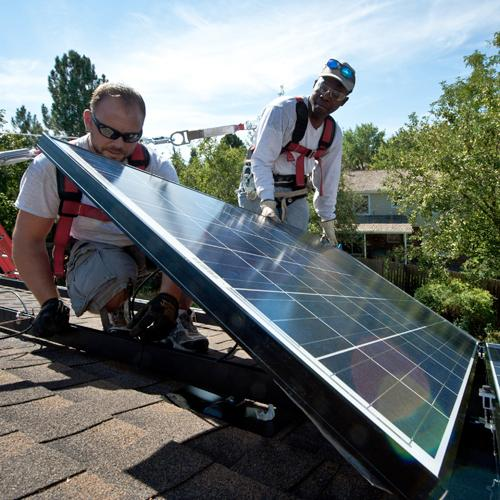 Workers installing solar panels on a home in Englewood, Colorado, in 2012