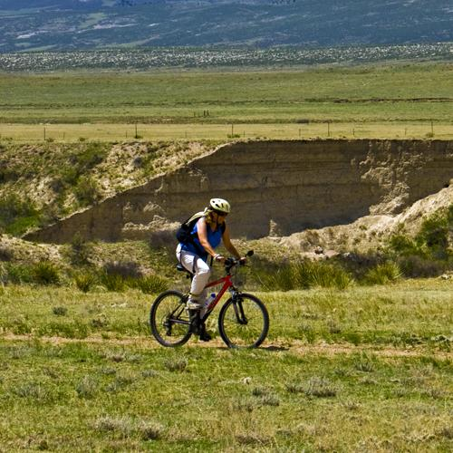 A woman rides a bike in Fort Collins CO