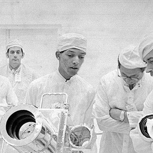 Inventor George Carruthers in a clean room with others in lab gear