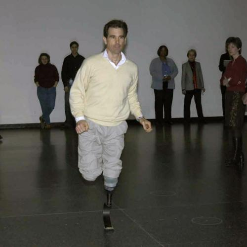 Photo of Van Phillips running using his invention, the Flex-Foot