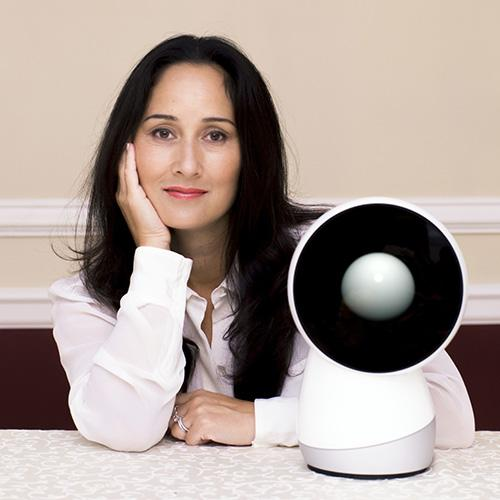 Breazeal posing with rounded robot