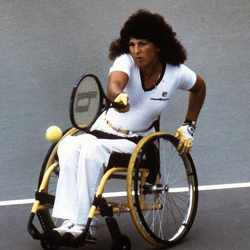 Hamilton playing tennis in a wheelchair