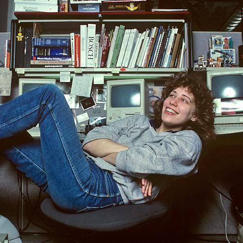 Susan Kare with her feet up at her desk