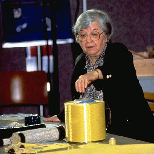 Kwolek with large spool of yellow Kevlar fiber