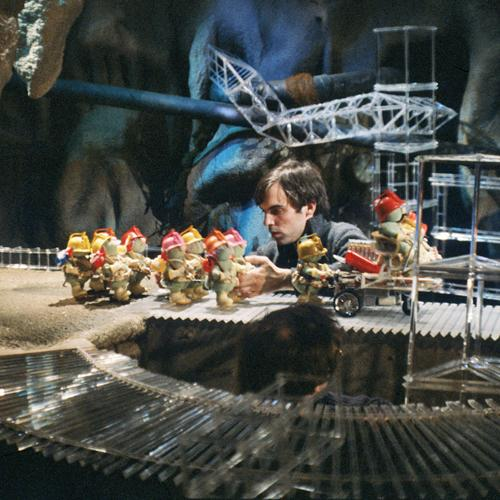 Tom Newby manipulating miniature figures on a movie set