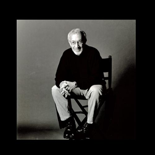 Stan Winston sitting in a director's chair