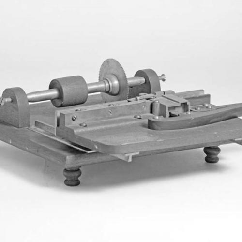 Patent model for tabletop portable printing press invented by JJ C Smith