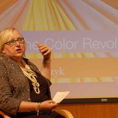 Regina Lee Blaszczyk speaks at a program about color and fashion design.