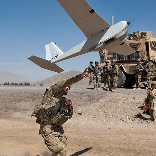 Soldier launching a drone for imaging with PUMA Unmanned Aerial Vehicle and DJI Matrice Hexacopter