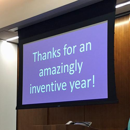 The words Thanks for an amazingly inventive year! are visible on a projection screen.
