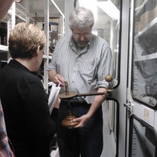 Curator Steve Turner with a scientific instrument
