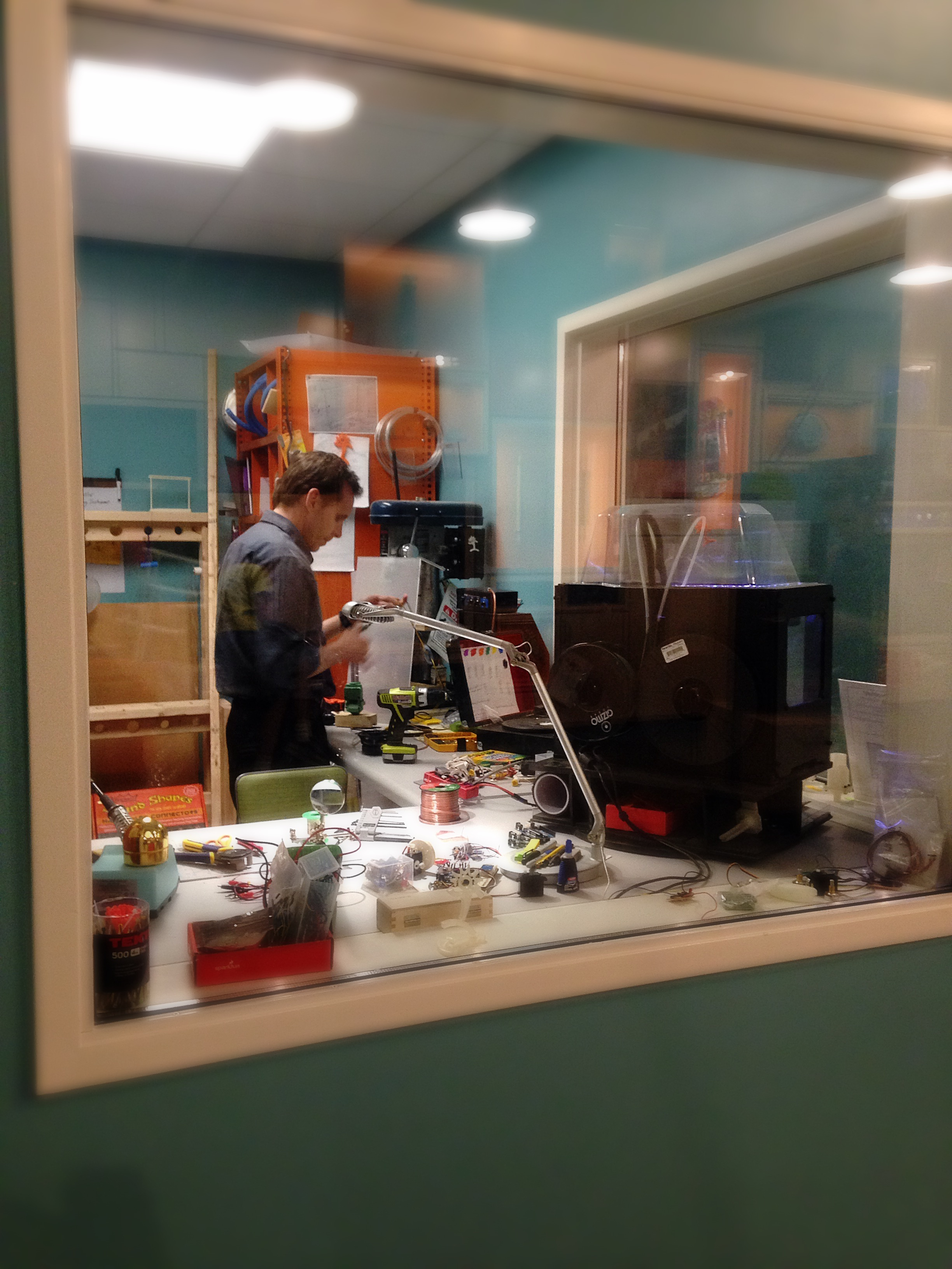 Tim at work inside his office, which looks out into Spark!Lab